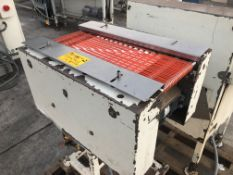 """8"""" wide x 24"""" long conveor with orange belts. Loading is free. Skidding or crating fees are"""