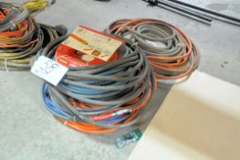 Lot-Various Hoses on Floor Under Bench