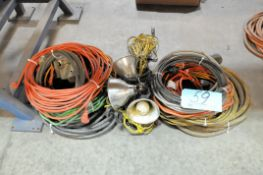 Lot-Extension Cords and Lights on Floor Under Bench