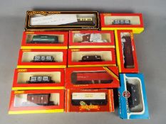 Airfix, Hornby - 12 boxed items of OO gauge mainly freight rolling stock.