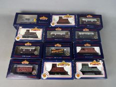 Bachmann - 12 boxed items of OO gauge freight rolling stock by Bachmann.