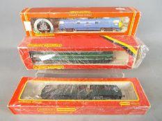 Hornby, Triang - Three boxed Hornby OO gauge Diesel locomotives.