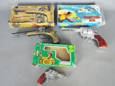 Lone Star, Crescent, Cap Guns - A collection of three boxed vintage toy cap guns.