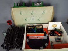 Hornby - An unboxed Hornby O gauge clockwork train set and accessories.