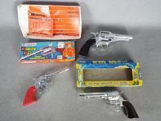 Lone Star, BCM (Derby), Hubley - Three boxed 'Cowboy' cap guns.