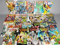 Marvel - A collection of 23 modern age comics majority 'Classic X-Men' some of which are contained