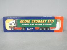 Tekno - A boxed Tekno #50 diecast 1:50 scale ERF Curtainside 'Eddie Stobart' from 'The British
