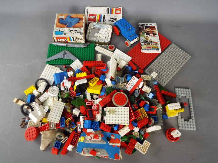 Lego - A plastic tub containing a boxed vintage Lego #101 4.