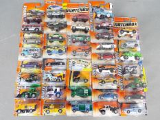 Matchbox - Approximately 40 blister carded modern issue Matchbox diecast vehicles.