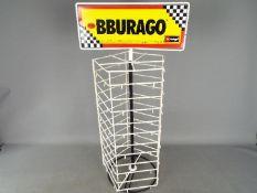 Bburago - A metal pentagonal point of sale Bburago branded display stand.