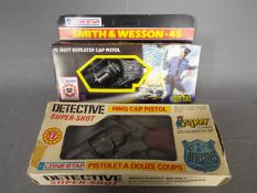 Lone Star - Two boxed 'Police' cap guns. Lot contains Lone Star #1274 Smith & Wesson .