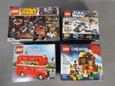 Lego - Four boxed Lego sets.