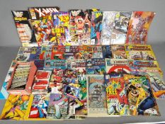 A collection of comics to include X-Men, Marvel Transformers, Spider-Man and similar,