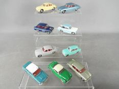 Dinky Toys - A collection of 9 unboxed diecast Dinky Toys all with spun hubs.