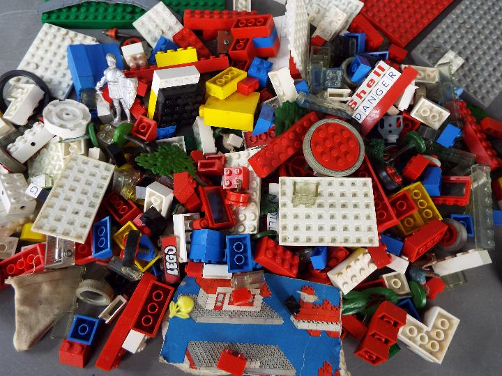 Lego - A plastic tub containing a boxed vintage Lego #101 4. - Image 3 of 3