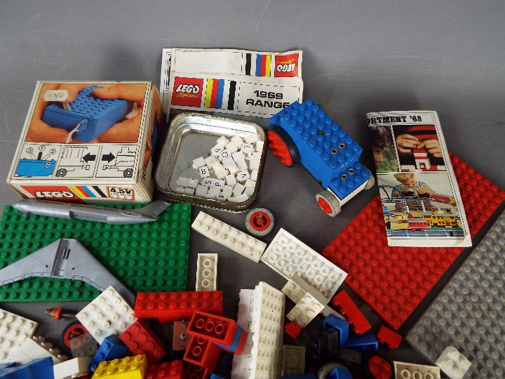 Lego - A plastic tub containing a boxed vintage Lego #101 4. - Image 2 of 3
