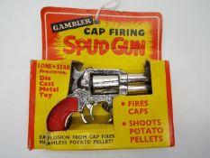 Lone Star - A boxed Gambler Cap Firing Spud Gun.