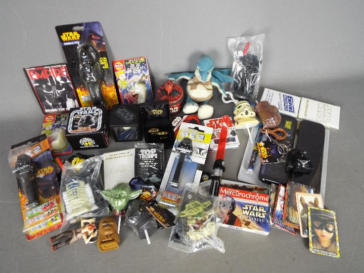 Lego, Walkers, Tomy, Others - A mixed collection of Star Wars related toys,