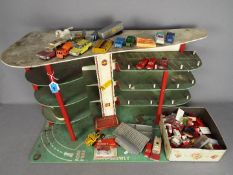 Lego, Dinky Toys, Husky, Corgi - A vintage unboxed and unmarked three storey toy car park / garage,