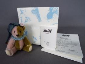 Steiff - A boxed Steiff Mini Bear # 034510 'Harlequin', white tag,