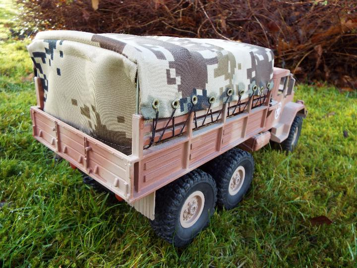 An RC controlled military truck with power bank and flashing lights. - Image 5 of 8
