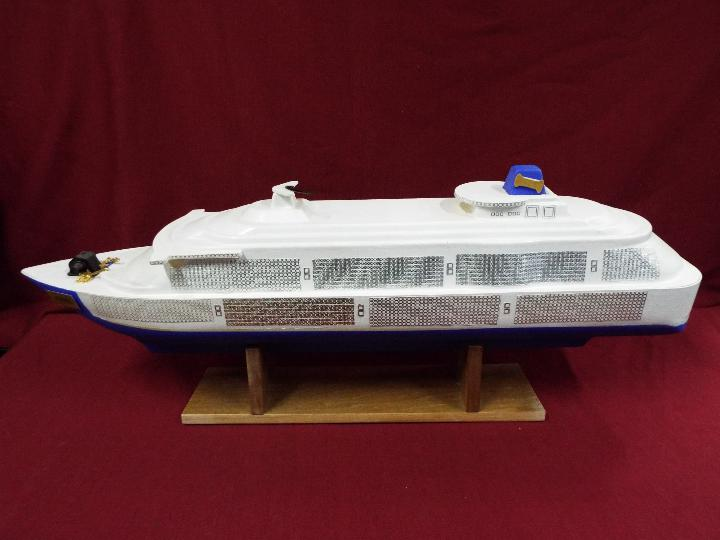 A large plastic model of a cruise ship 'Joshie'.