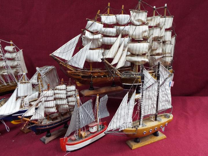 A flotilla of ten static wooden models on stands depicting fishing vessels, - Image 3 of 4