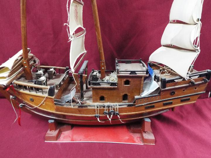 A static wooden model of a Chinese Junk. - Image 2 of 5