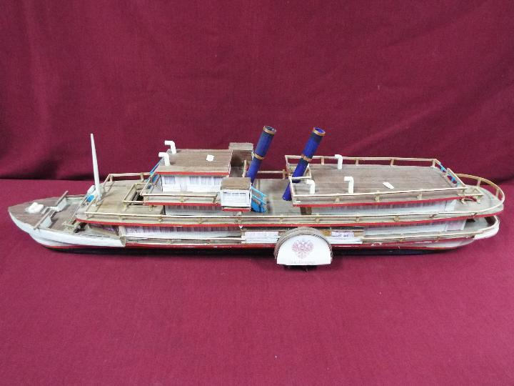 A wooden model of a Russian Paddle Steamer 'St.Petersburg'.