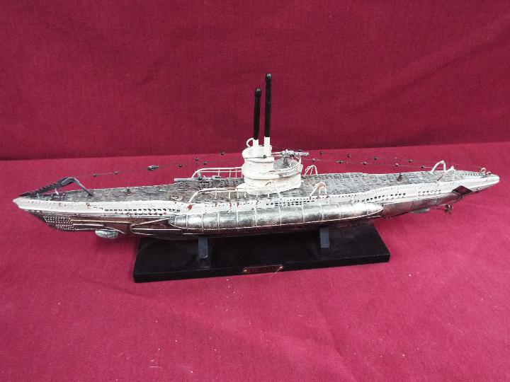 A resin model on stand of a U-Boat measuring approximately 20cms (H) x 48cms (L) x 7cms (W) - Image 4 of 4