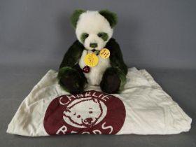 Charlie Bears - A Charlie Bears soft toy teddy bear in the form of a panda, # CB614989 'Mistletoe',