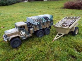 An unmarked Six-wheel four-wheel drive radio controlled US army truck, possibly by JJRC.