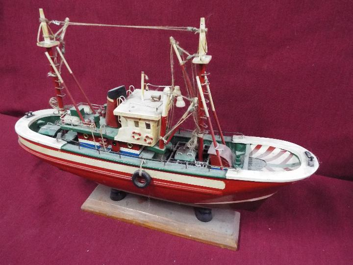 An unmarked wooden static display boat on stand, - Image 2 of 4