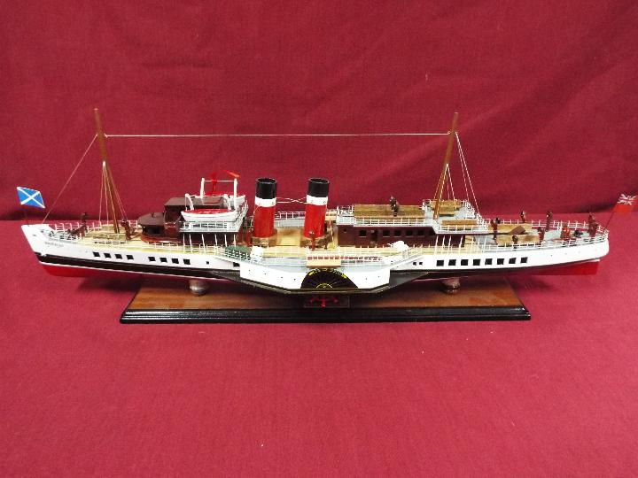 A display model of the last sea-going paddle steamer 'Waverley'.