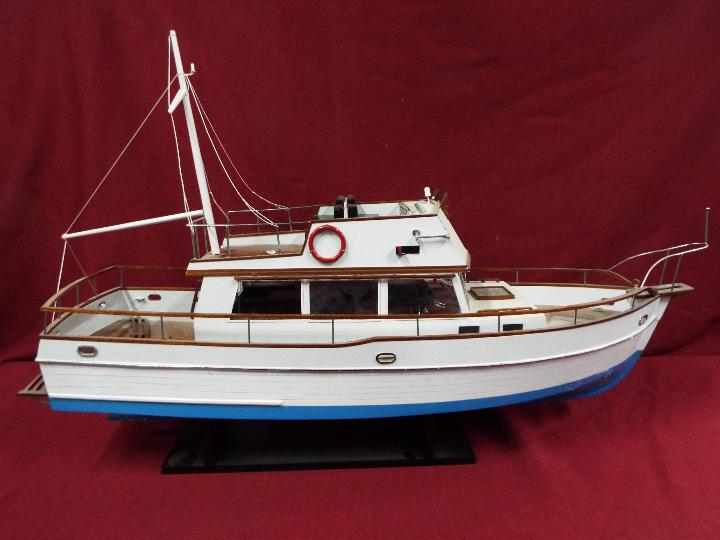 A 'Grand Banks 32' static model yacht.