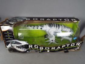 Radio controlled Robonetics Roboraptor animated dinosaur in original box,