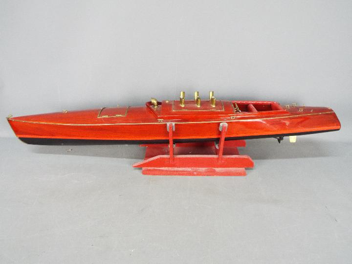 A large wooden radio controlled model of a Venetian State launch.