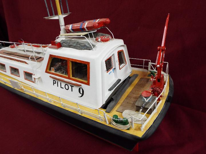 A scratch built model of a Pilot Boat measuring approximately 45cms (H) x 87cms (L) x 25cms (W). - Image 4 of 5