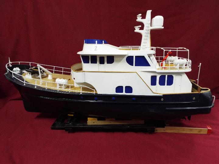 A 'Grand Banks' radio controlled luxury model yacht.