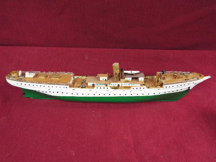 A resin model on stand of a U-Boat measuring approximately 20cms (H) x 48cms (L) x 7cms (W) - Image 2 of 4