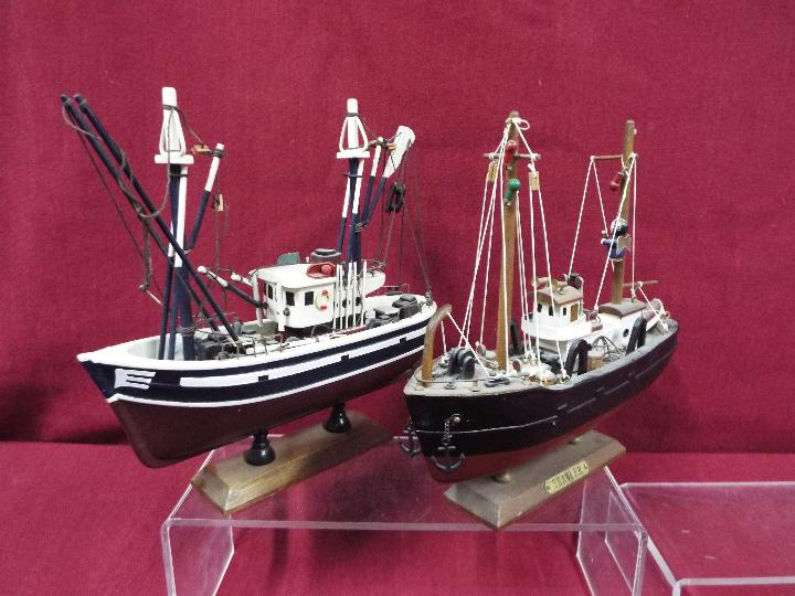 A flotilla of five static wooden models on stands depicting fishing vessels. - Image 3 of 4