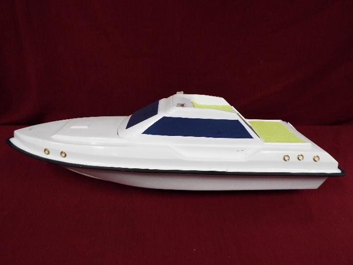 A fibreglass model of a luxury yacht.