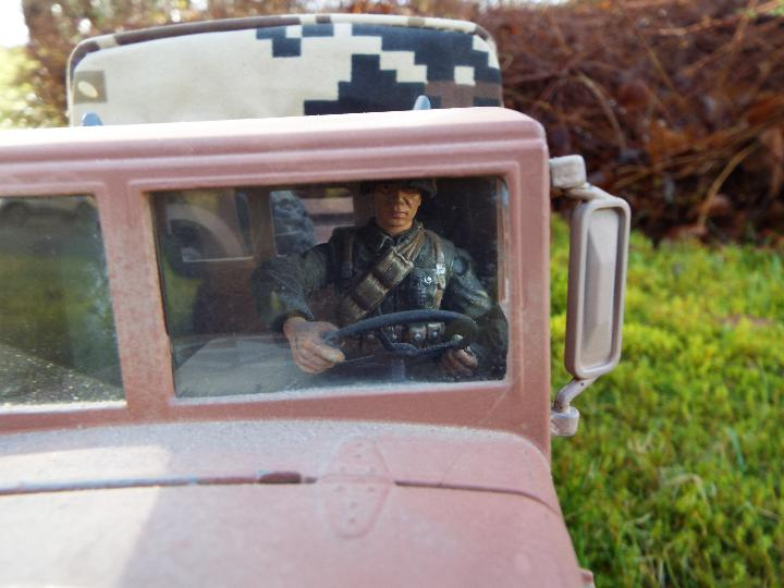 An RC controlled military truck with power bank and flashing lights. - Image 4 of 8