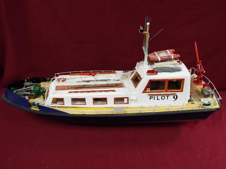 A scratch built model of a Pilot Boat measuring approximately 45cms (H) x 87cms (L) x 25cms (W).