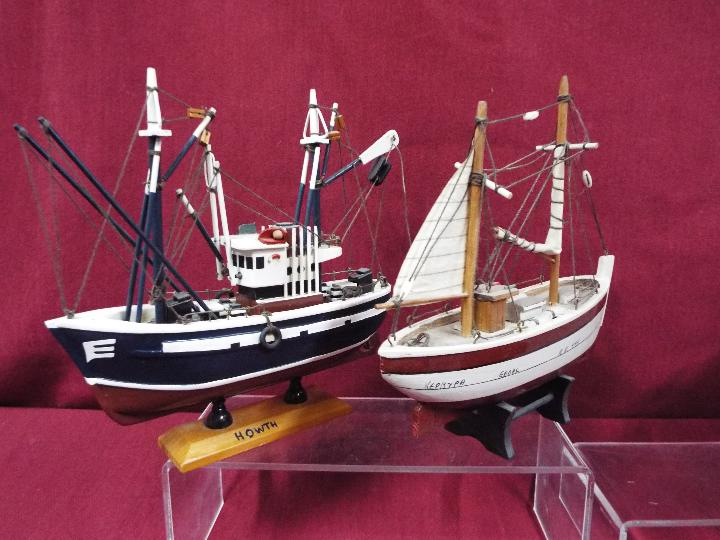 A flotilla of five static wooden models on stands depicting fishing vessels. - Image 2 of 4