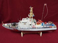 A twin Propeller Remote Control Coast Guard Patrol Boat 'Excellent Endless Power'.