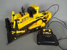 Matchbox - An unboxed 1990s Matchbox wired remote controlled Caterpillar Bulldozer.
