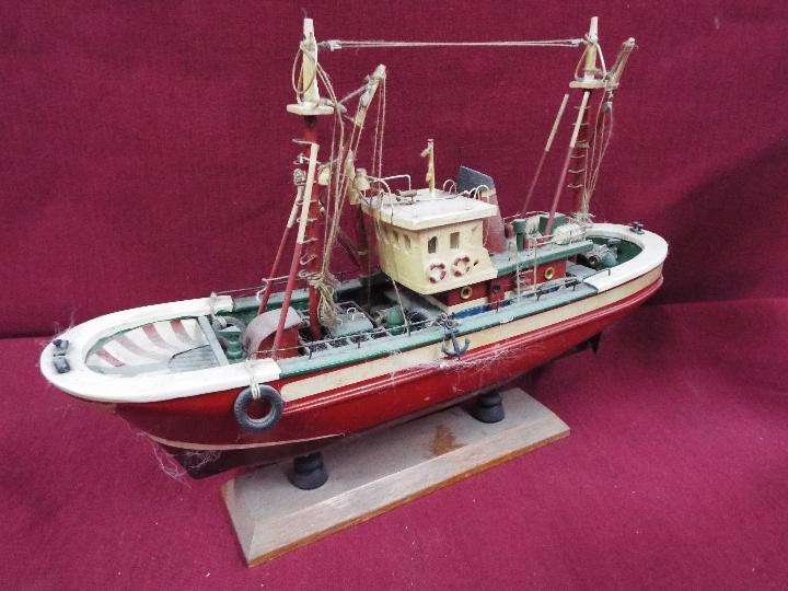 An unmarked wooden static display boat on stand, - Image 3 of 4