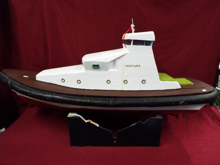 A fibreglass constructed prototype model of a yacht entitled 'Venture' .