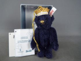 Steiff - A boxed limited edition Steiff 'Lladro Ornament Bear', # 677649, white tag and certificate,